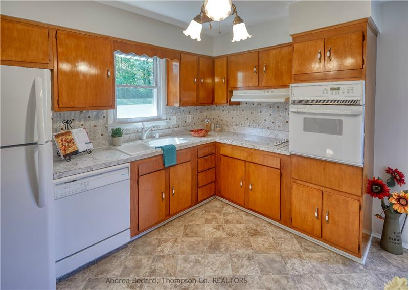 Charming vintage kitchen with back-yard views...