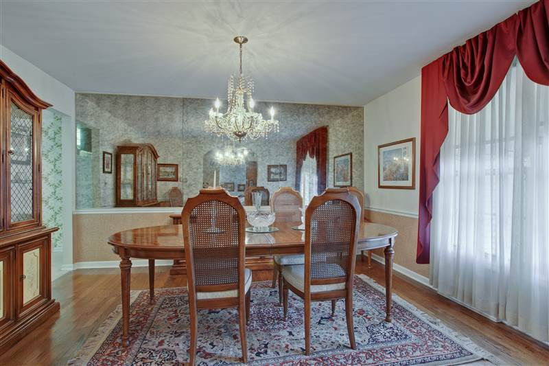 The separate formal dining room highlighted with oak hardwood flooring is located off the foyer and also conveniently adjoins th