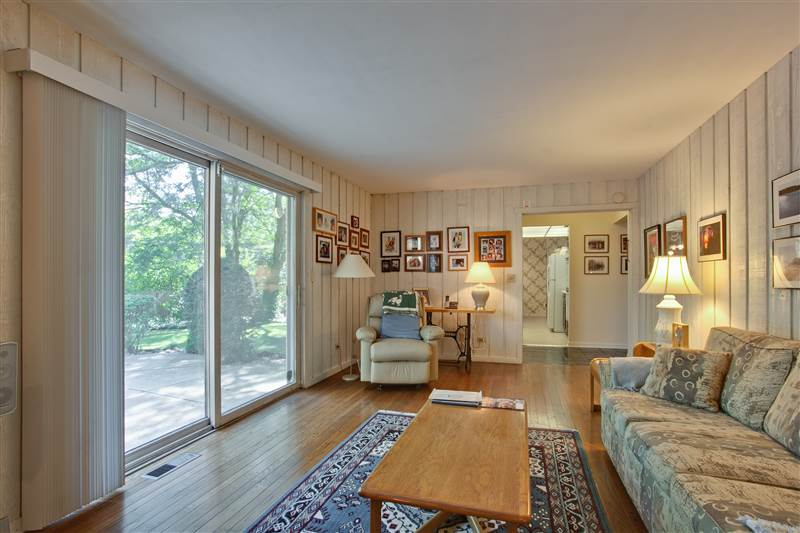The family room with its sunny views of the patio and backyard has sliding door access to both.