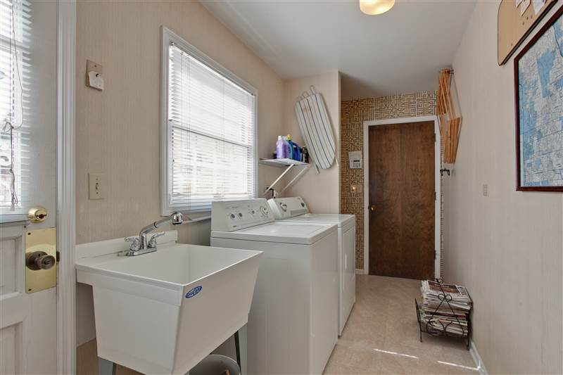 Located off the kitchen, the laundry/mud room has a convenient side door, laundry tub, storage area and access to the attached 2