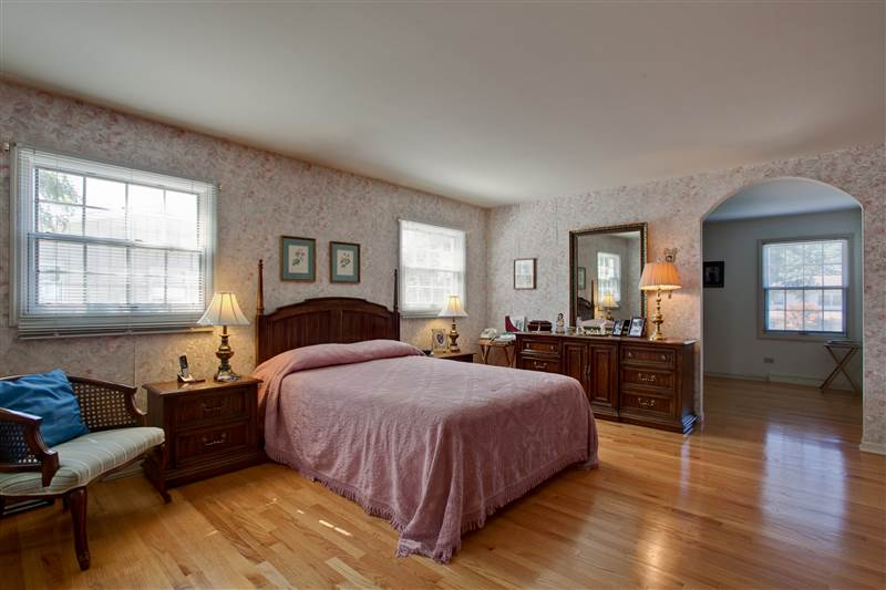 A true two-room suite, the master bedroom is adjoined by a spacious sitting room -- ideal for a quiet library, den, office, nurs