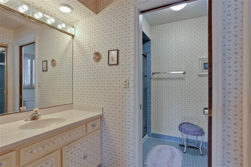 The compartmented master bath features a separate commode/shower room.