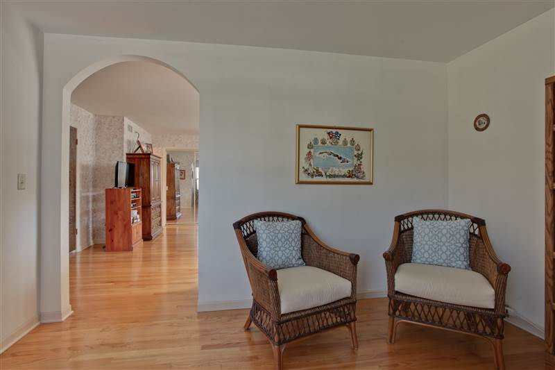 The sitting room connects to the master bedroom through an open arched doorway.