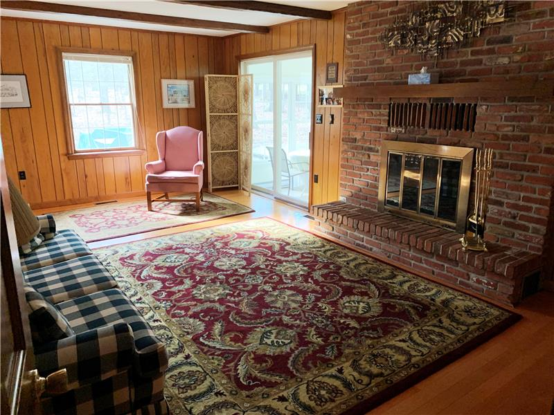 Family room with woodburning fireplace