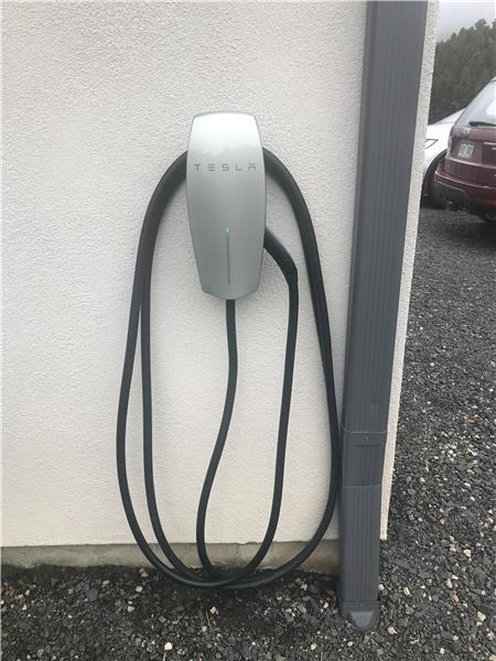 Tesla wall connector is included.