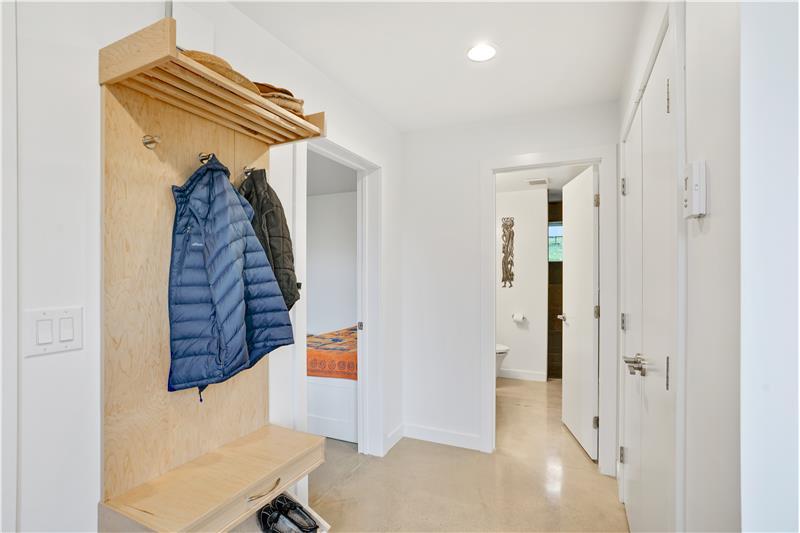 Inside front door; 3/4 bath ahead, bedroom to left