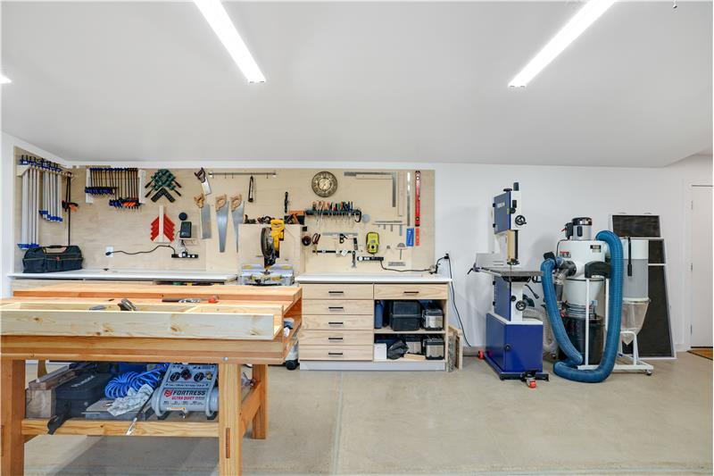 The workbench against the far wall is included