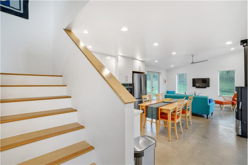 Stairs between kitchen and foyer