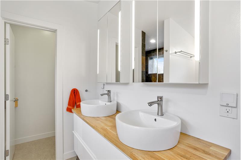 Master bathroom has double vanity, separate room for toilet