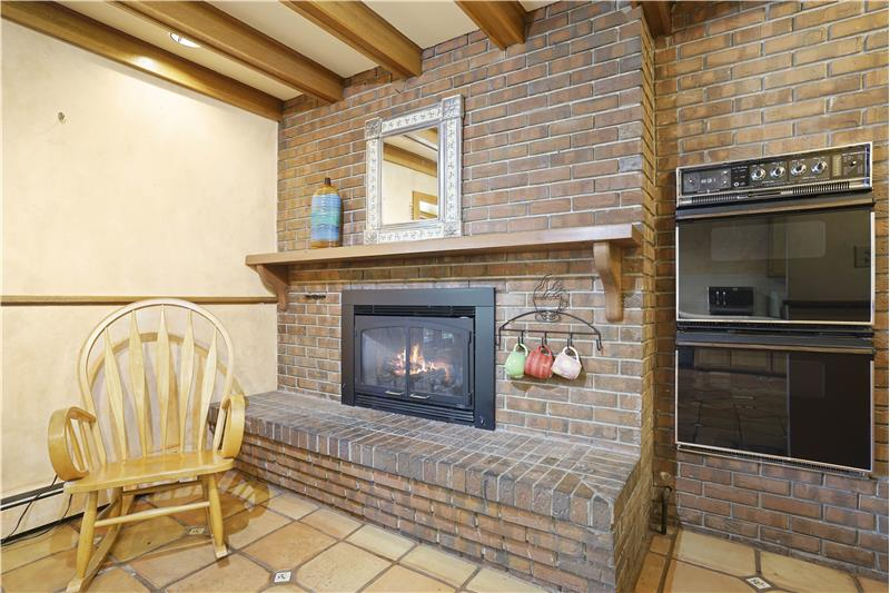 Gas fireplace and double oven in the kitchen