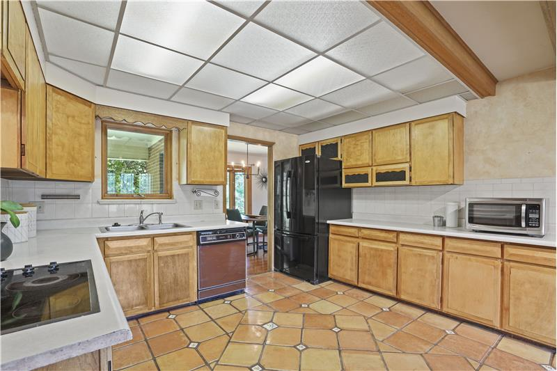 Great lighting and Saltillo tile floor in the kitchen