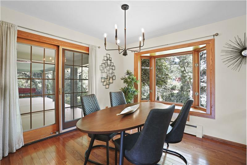 Dining room has bay window to the backyard and sliding glass door to the covered patio.