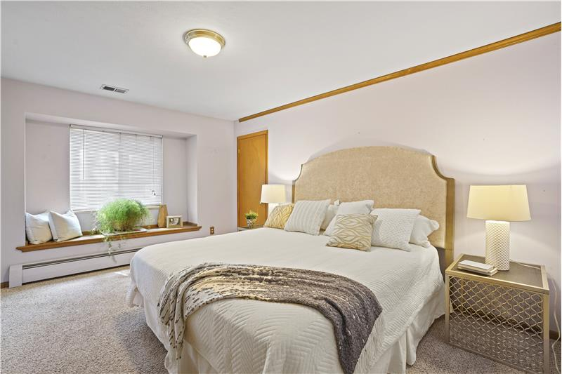 Master bedroom has two closets and window seat to the front yard plus an en suite bathroom.
