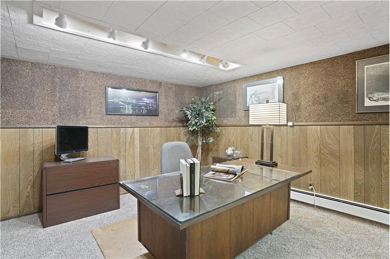 The basement bedroom is used by Seller as his office. It has above-grade windows to the back and side yards.