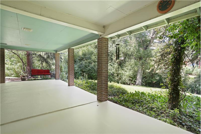 The 32-foot-long cover patio is behind the garage and kitchen.