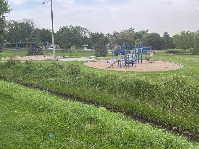The park has a swingset and play structure.