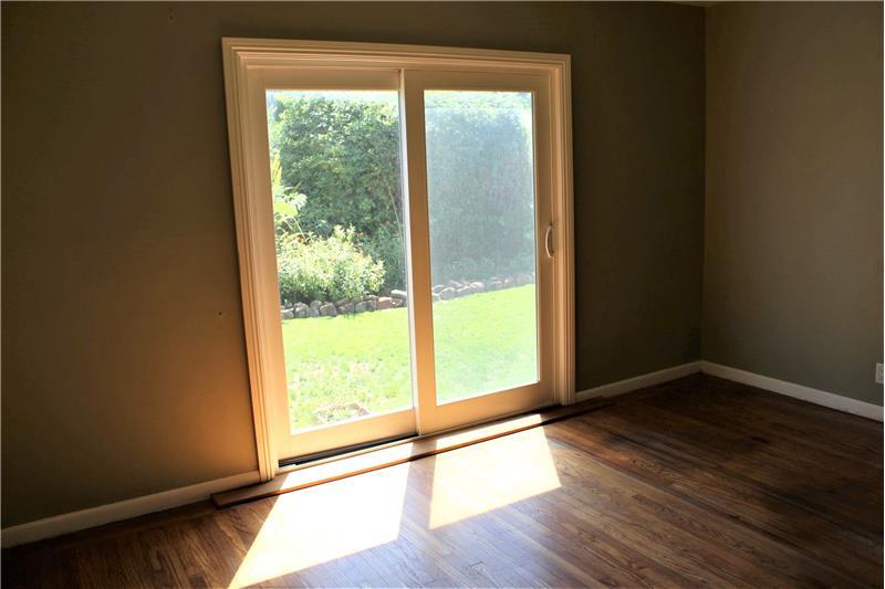 Siding Glass Door Leads to Backyard