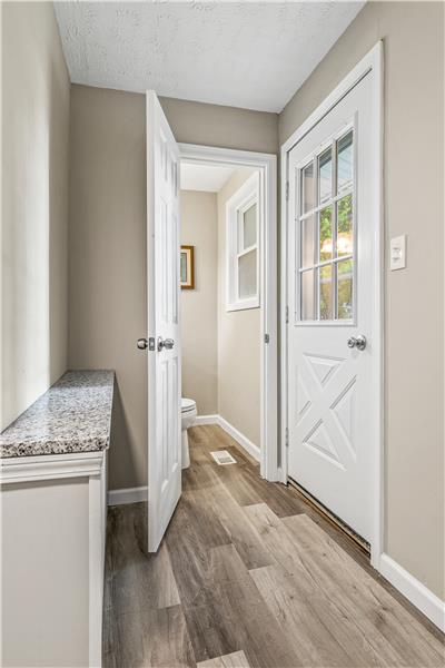 Laundry room with access to backyard