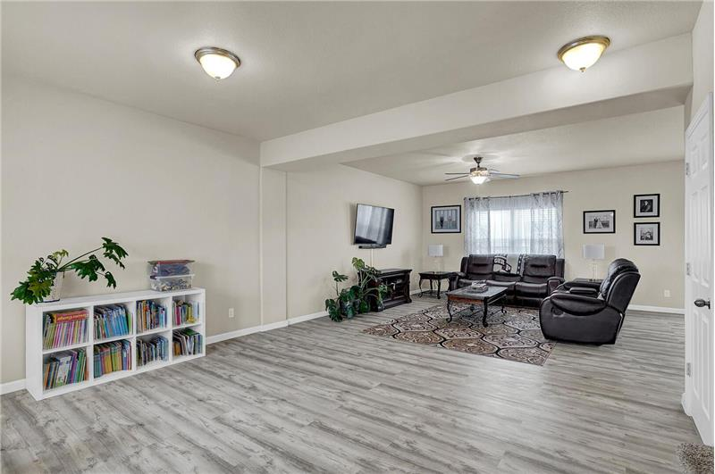 Open floor plan with beautiful, engineered wood floors on the main level and large living spaces