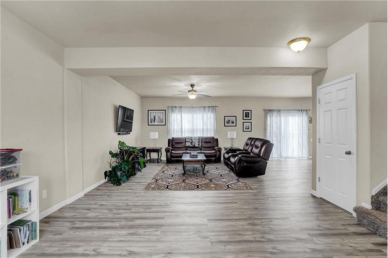 The Living Room flows into the Family Room filled with lots of natural light