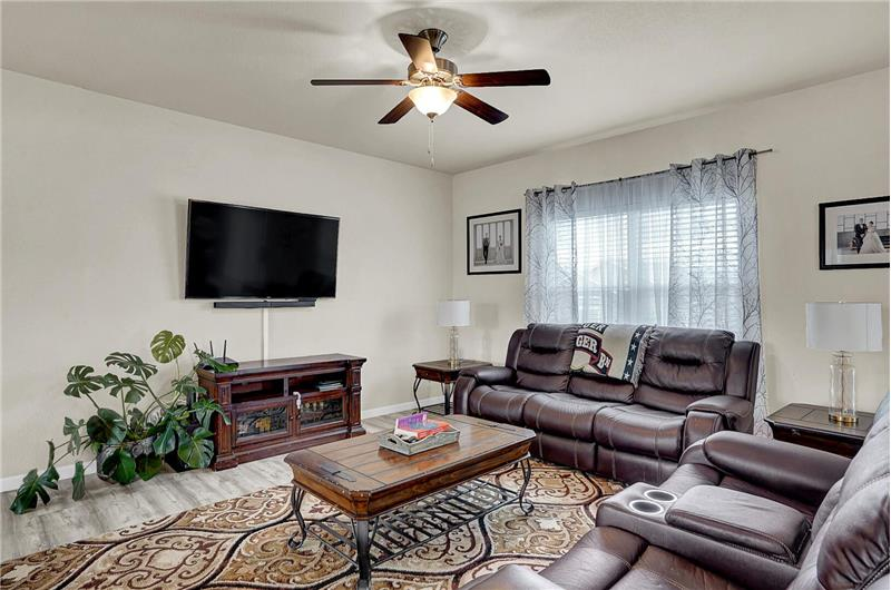 The Family Room features a lighted ceiling fan and a large window that brings in lots of natural light