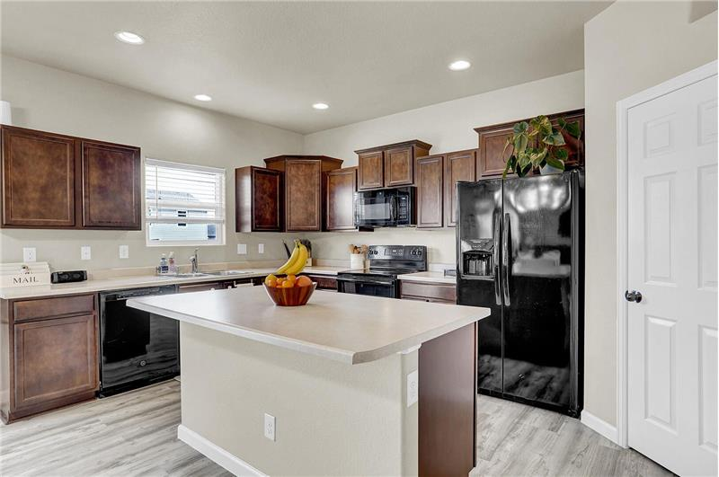 The Kitchen features a counter bar off the island, plentiful cabinets, and a walk-in pantry