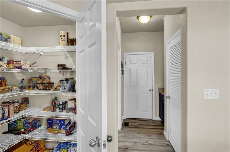 Walk-in pantry and hallway to Powder Bathroom and Garage