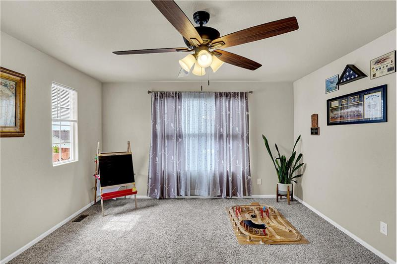 Upper-level Loft with neutral carpet and large window