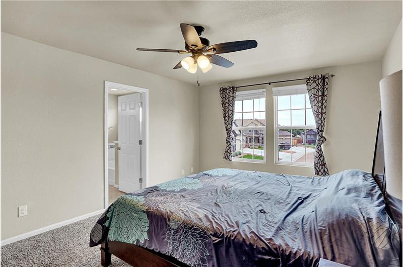 The upper-level Master Bedroom has an adjoining 5-piece Master Bathroom