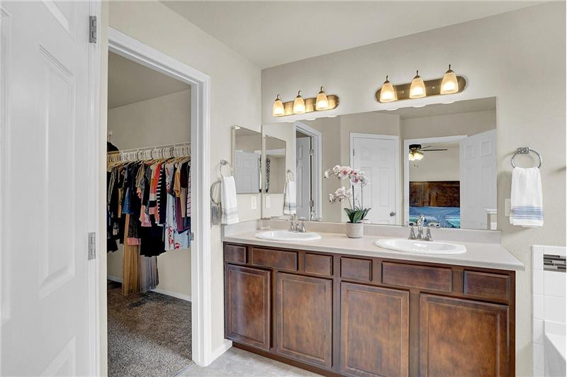 The Master Bathroom features a walk-in closet and dual sink vanity