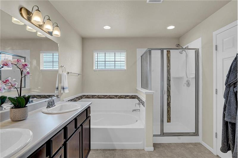 The Master Bathroom also boasts a soaking tub and separate shower