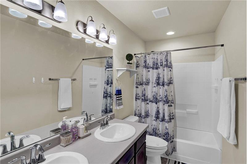 Upper-level full Hall Bathroom with dual sink vanity and tub/shower