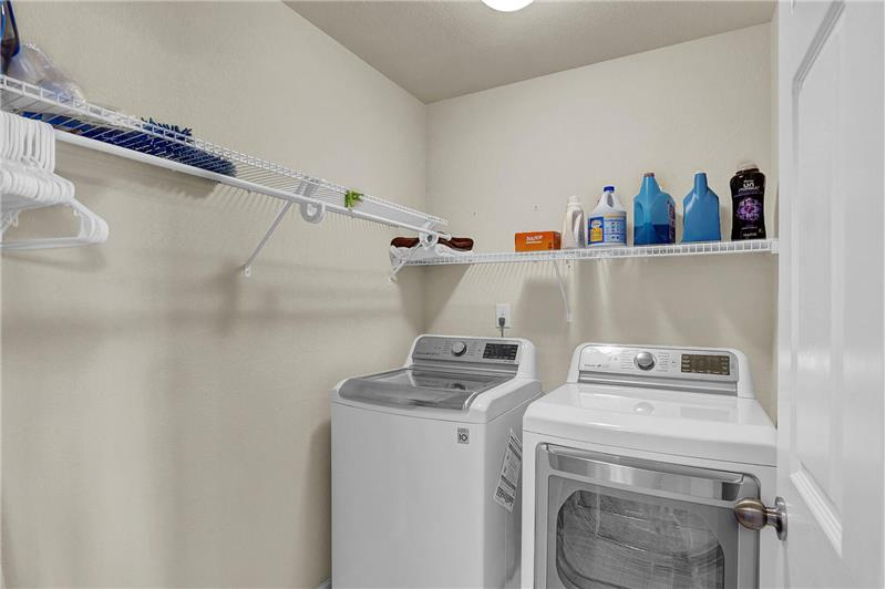 Upper-level Laundry Room with built-in shelves