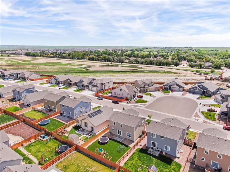 Aerial view of backyard and neighborhood