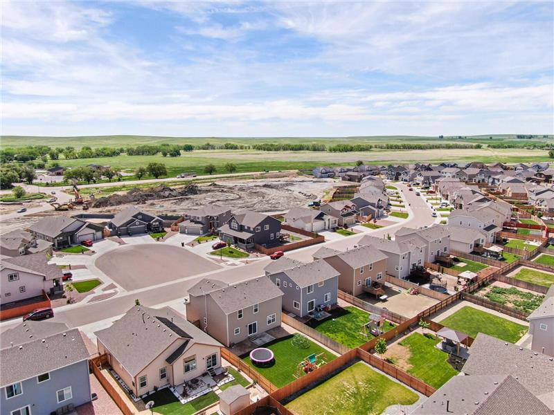 Aerial view of backyard and neighborhood open space