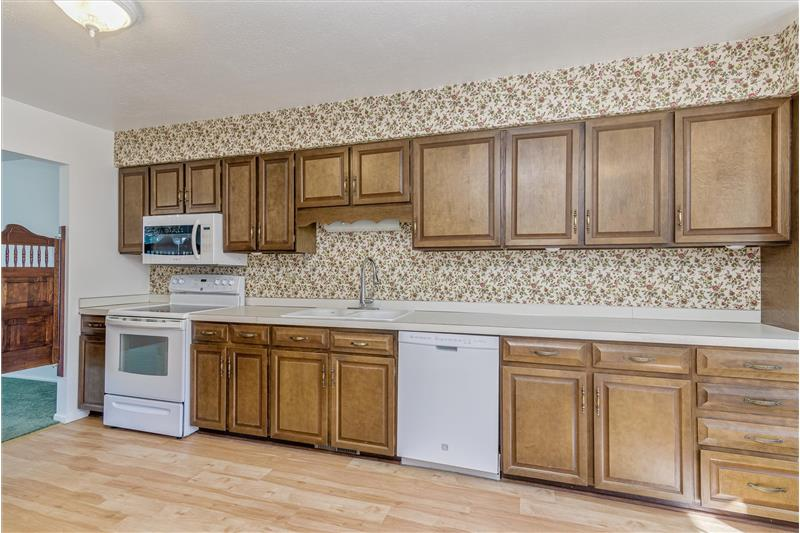 Handles on all cabinets. All appliances included