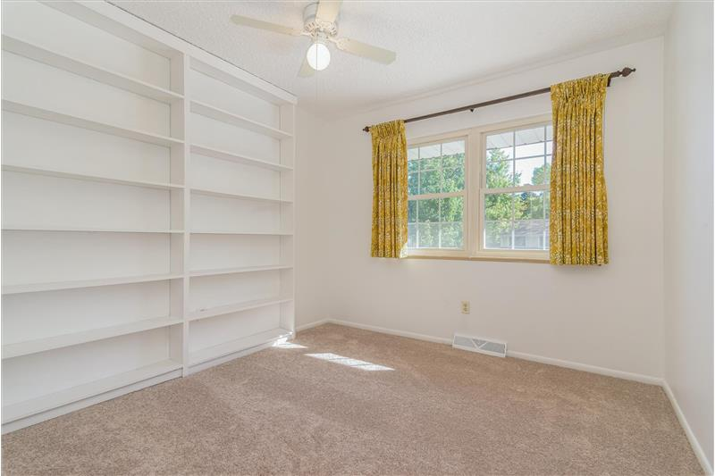One guest bedroom has lots of built-in shelving. Would make a fine office!