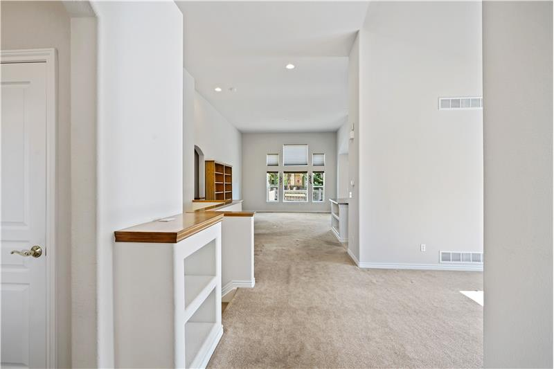 View from the 6'x9' tiled foyer. Dining room at right, family room & kitchen beyond