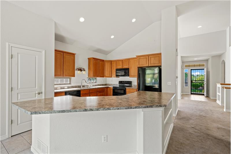 Kitchen has granite-like Formica countertops in excellent condition