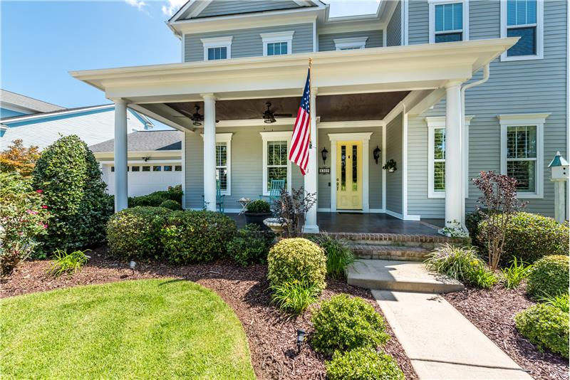 Wonderful curb appeal and beautifully landscaped walkway to the home.