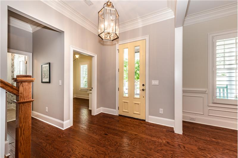 Gracious foyer with hardwood floors and extensive mill work.