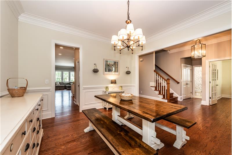 Plenty of room in the dining room for china cabinet, side tables. Gleaming hardwood floors, generous mill work.