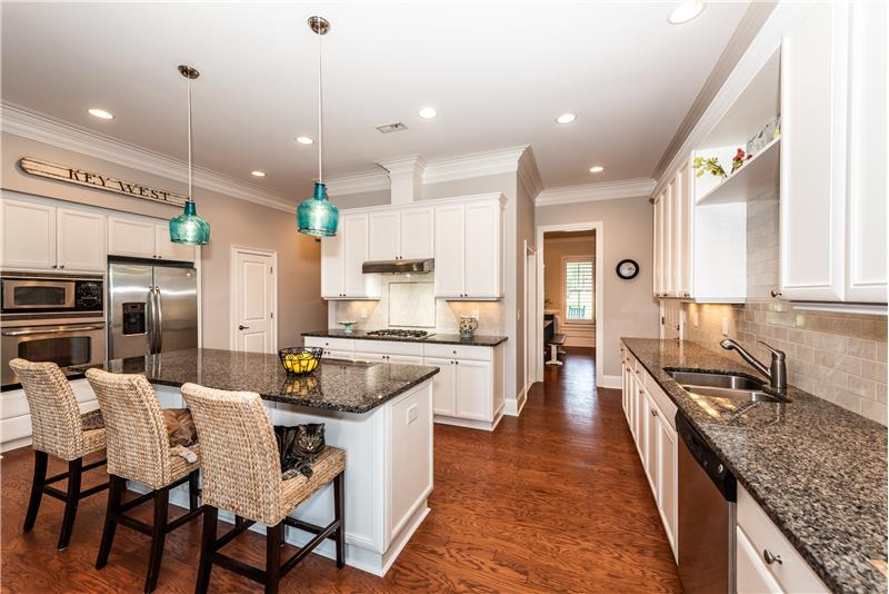 Center island, stainless steel appliances, gas cook top, granite counters.