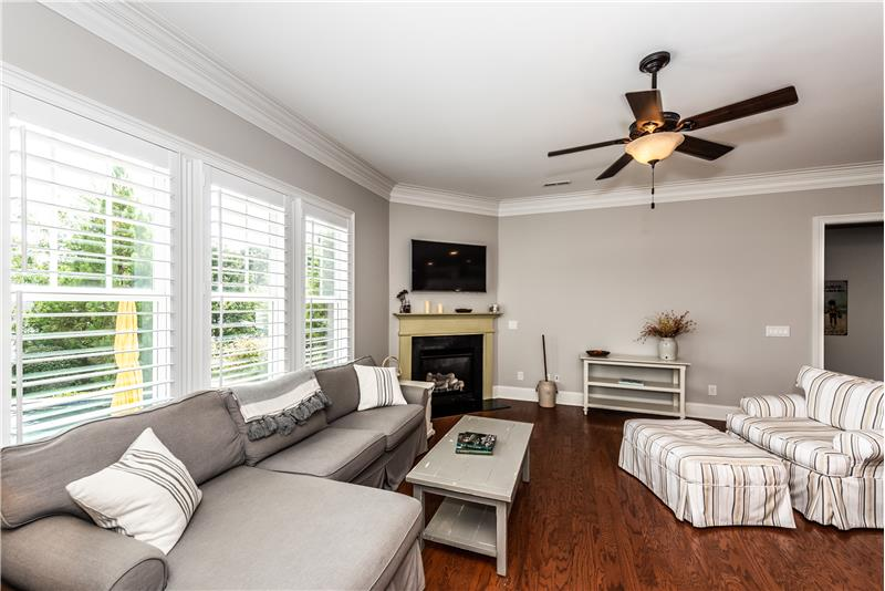 Bright and sunny great room. Plantation shutters throughout the first floor of the home.