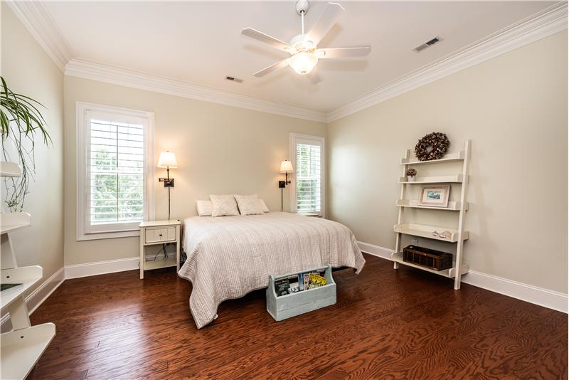 Serene and spacious owner's suite on the main floor of the home. Easily accommodates a king-size bed, large dressers.