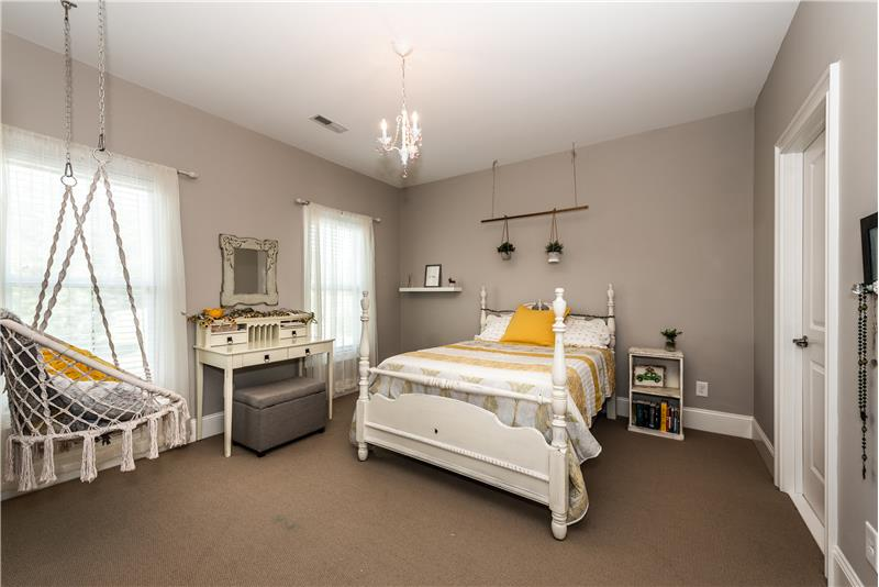 One of four secondary bedrooms on upper floor of home with en-suite access to the Jack & Jill bathroom.