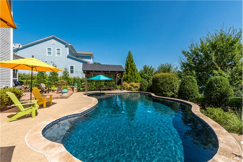 Pool features salt water chlorination, underwater lights, tanning ledge.