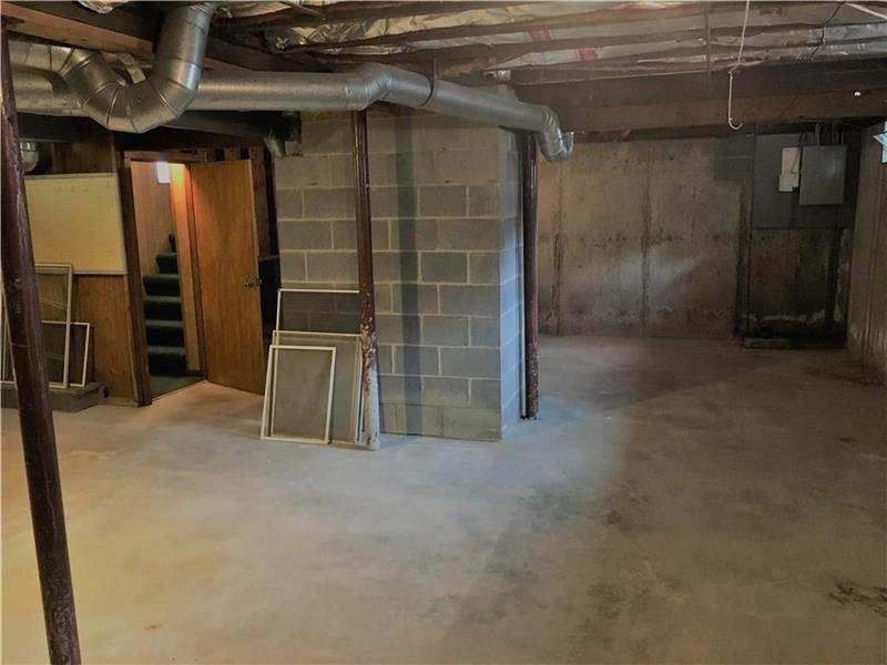 Full huge basement with workshop & access to first floor & outside with door & bulkhead.