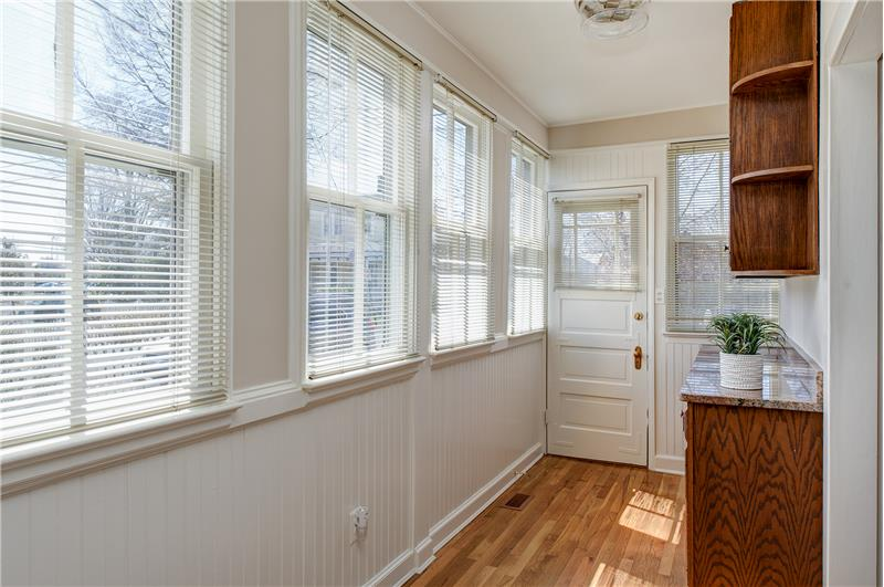 Sun-porch addition with extra cabinets and side-porch door