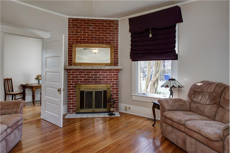 Cozy little family room with wood-burning brick fireplace